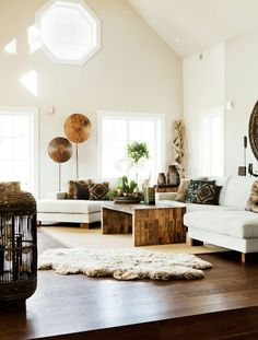 Sometimes the nicest thing to do in a tall space is pick some low elements. We love this eclectic Bohemian living room.