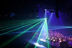 A laser show is a live multimedia performance. Laser Stage Lighting, Strip Lighting, Party Lighting, Diffuse Reflection, Laser Show, Light Emitting Diode, Battle Ground, Display Technologies, Event Management