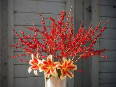 When you're ready to arrange your harvested winterberry branches, trim off about an inch from the ends. Remove and discard any berries that would be below the water line in your container; this will help prevent bacteria from growing. Then add fresh water and a floral preservative. Change the water as needed.