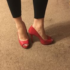 Red High Heels In awesome used condition. Few spots have wear and tear (as you can see on heel). I would say they are about 4 inches high. They are surprisingly very comfortable! Call It Spring Shoes Heels