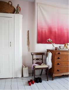 http://www.marthastewart.com/271427/ombre-craft-projects?czone=crafts/crafting-tools-center/crafting-tools-projects=276982=275022=271427  I absolutely love the pink and white ombre sheet as artwork. So easy and sweet- RIT dye maybe? The flowers tie everything together too. Love it.