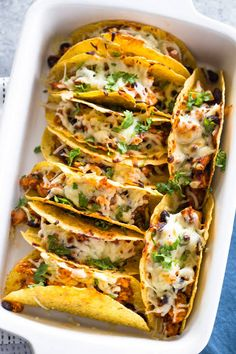 This Easy Oven Baked Chicken Tacos Recipe is PERFECT for a quick weeknight dinner! OVEN BAKED chicken tacos have lots of flavor and none of the stress. This Easy Chicken Tacos Recipe is the most popular recipe on The Cookie Rookie and has been pinned over Easy Oven Baked Chicken, Baked Chicken Tacos, Chicken Taco Recipes, How To Cook Chicken, Mexican Food Recipes, Dinner Recipes, Cooked Chicken, Chicken Taco Bake, Oven Baked Tacos
