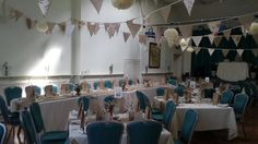 Handmade bunting decorated with handmade paper flowers.