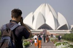 A man photographs at the Baha'i House of Worship (Lotus Temple), one of the best known landmarks of New Delhi, India