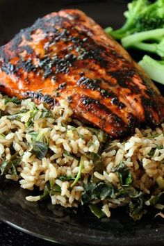 Summer Salmon Over Cilantro-Lime Rice with Kale 4 tbsp lime juice, separated 1 tsp dried cilantro 1 tbsp honey (21g) 2 salmon fillets About 1/2 lb raw kale chopped 3-4 scallions diced 2 cups of cooked brown rice (I use the 90 second bagged kind) About 1/4 cup fresh cilantro Kosher Salt