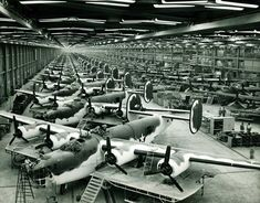 """B-24s in the  Consolidated-Vultee Plant, Fort Worth, Texas–the other Liberator Plant.  In foreground are Liberator bombers while to the rear of this front line are C-87 """"Liberator Express Transports"""" in various assembly stages. The second line is composed entirely of B-24 Liberator bombers in final assembly stages. Photo via Hometown by Handlebar Blog"""