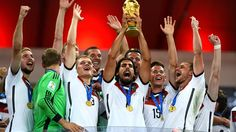 Sami Khedira of Germany lifts the World Cup