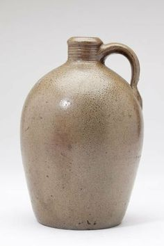 NC Pottery Jug, H. Fox (Himer Jacob Fox, Chatham County, 1826-1909) half gallon size, salt glazed stoneware, very well turned with incised lines below spout and strong stamp/capacity mark (2). 9.5 in.