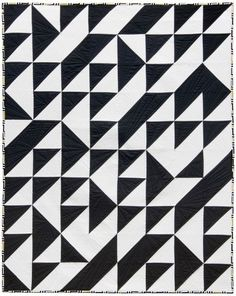 "= free pattern = Turning Triangles quilt, 44 x 55"", at Robert Kaufman Fabric Company"