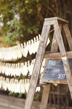 Hanging guest seating chart display   via loveyourdaydesignsblog.com   Wedding Wednesday: Find Your Seat