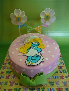 Smurfette (Schtroumpfette) - A cake with the Smurfette on it for Felicia, 6 years old. Rainbow cake with buttercream covered with fondant. All details are fondant.