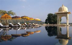 The world's best hotel pools -   The Oberoi Udaivilas, India -   The luxurious Oberoi Udaivilas, in the heart of Rajasthan, is surrounded by swimming pools and perfectly-manicured courtyards.