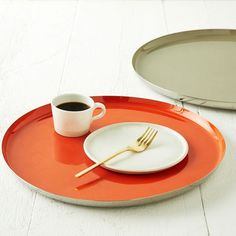Our Enamel Round Trays are a retro update to the classic rectangular tray shape. Use them as catchalls on a coffee table or cocktail servers at parties.
