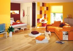Cheerful studio in yellow Erfurt wall coverings.