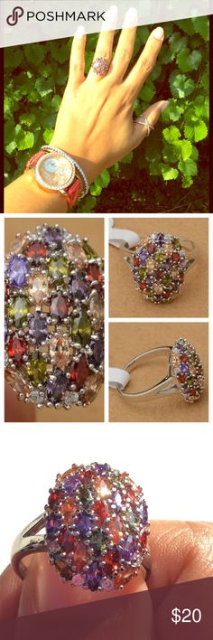 925 Stamped Beautiful Multicolored Garnet Ring Beautiful sterling silver ring amethyst, garnet and topaz multicolored stones. Pictures do not do this ring justice. All jewelry in the first picture are available for sale. Get a better deal when you bundle. Red, Green, Purple, Orange and White colors on the ring. Jewelry Rings