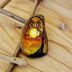 DREAM ON , first in a collection of rocks that inspire to let thoughts run free and wild #paintedrock #rockart #sunset #fantasy #fantasyart #australia #thestunnerboutique #treeoflife #daystoremember #landscape #rustic #beautifulrocks #redclouds #watercolour #autumn #dreamon #etsystore