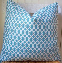 Aqua geometric pillow cover.