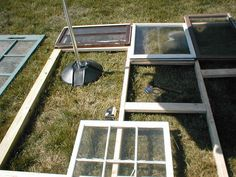 Pretty good instructions with pictures on how to build a greenhouse from old windows. You can see how the framing and window attachment are done.