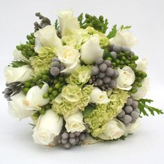 DIY bridal bouquet combo!! White roses, green hydrangeas, green hypericum, and (my new favorite) silver brunia. I REALLY REALLY love this!!!
