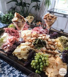 Gorgeous Charcuterie and Cheese platter:  a larger mirror as the base of the spread with various sized martini glasses holding the rest of the goodies.
