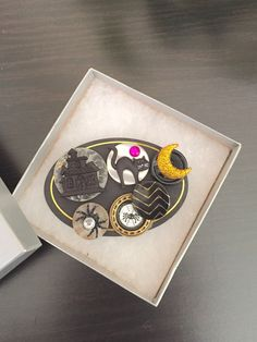 A Holloween brooch created from buttons and small symbols of the season by OnTheButtonPath on Etsy