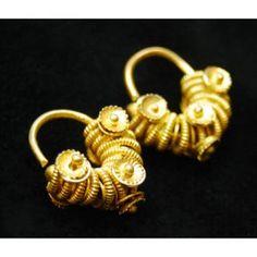 Earrings Medium: Gold alloy Dimensions: A: 1.9 x 1.6 x 0.9 cm (3/4 x 5/8 x 3/8 in.) B: 2 x 1.7 x 0.9 cm (13/16 x 11/16 x 3/8 in.) Credit Line: Gift of Dr. Marian Ashby Johnson Geography: Senegal