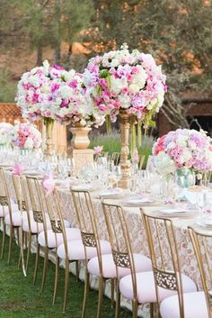 Feminine gold and pink wedding reception table with tall flower arrangements Tall Flower Arrangements, Tall Flowers, Wedding Flower Arrangements, Wedding Flowers, Pink Flowers, Wedding Dresses, Pink Wedding Decorations, Gold Wedding Colors, Pink And Gold Wedding