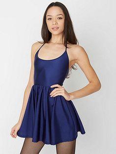 Short, flirty dress featuring a halter neck and breezy shirred skirt.