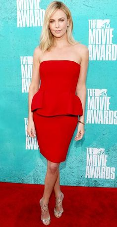 Charlize Theron wore a red peplum dress by Lanvin, Jimmy Choo shoes, and Cartier jewelry to the MTV Movie Awards