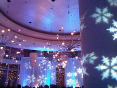 #Gobo projectors add dimension by projecting snowflakes onto pillars and curtains. #blue #uplighting #RentMyWedding #weddingideas