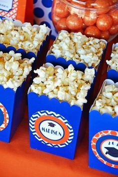 {Congrats 2013} Graduation Party Ideas! A bright orange and blue dessert table with grad cap cake pops, congratulations fruit cups & diploma scroll desserts.