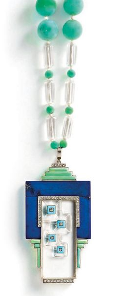 An Art Deco lapis lazuli, turquoise and rock crystal sautoir. The pendant of geometric design centred on a carved rock crystal plaque, within a lapis lazuli and turquoise frame, with blue enamel and rose and single-cut diamond accents, to a barrel-shaped rock crystal bead necklace, interspersed to the front with vari-size turquoise beads, circa 1930, pendant 8.5 cm long, necklace 70.0 cm long. #ArtDeco #necklace