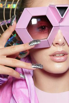 Futuristic --- Minx nails at Fred Butler S/S 2012. Big a@@ glasses!