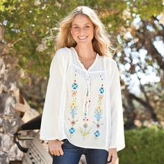 """SAVANNAH TUNIC--Front-to-back pretty with dainty beadwork, delicate ruffles, a lace hem, and rows of expertly embroidered blooms, our supple tunic is an allseason star. Cotton/viscose. Hand wash. Imported. Sizes XS (2), S (4 to 6), M (8 to 10), L (12 to 14), XL (16). Approx. 26-1/2""""L."""