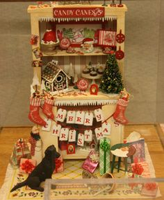 Altered cabinet in 1:12 scale decorated for Christmas by Kristine Hill and exhibited at the Spring 2011 Seattle Dollhouse Miniature Show