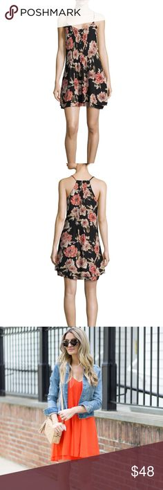 "Sanctuary Spring Fling Dress Spring Fling Dress in Black Poppies. Relaxed fit dress in a double layer design with allover floral print. V-neckline. Pintucks at the front bodice. Thin adjustable straps. Eyelash finish along the high-low hemline. 100% rayon. Machine wash and tumble dry. Approximate length 36"". Fits like a true Medium. (Third photo is to show on actual person, different color). Still on sale on many sites for $70+ dollars. Sanctuary Dresses Mini"