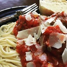 Chef John's Tomato Sauce  - Allrecipes.com Use pan, not glass dish.  Bake on parchment.  Add slightly more sauce.