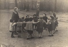 The Bericha-kindergarten teacher and children dancing in a gathering point at an unknown place.