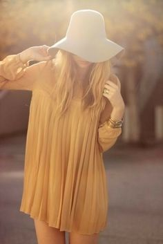 vintage cream dress and white floppy hat