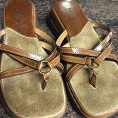 Cute leather strap it thong sandals Leather scrappy sandals by MIA in sz 7 1/2 NWOT. Has several crisscrossing straps. Very cute on. Suede footbed and leather heel. MIA Shoes Sandals