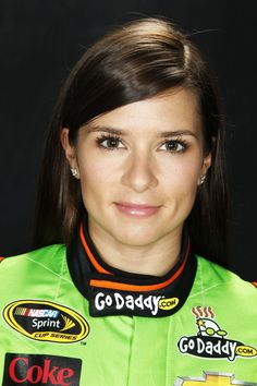 "This is Danica Patrick. She is a NASCAR  Driver. Danica and here car raced to win the POLE POSITION for the DAYTONA FIVE HUNDRED. That is the best position you can have to start this motor race. She is the first woman to ever do this.  If she could go on to WIN this race it would be a monumental accomplishment.   Danica is a very skilled Driver with a ""Hot"" Car. It is very possible that she will win.  I sure hope she does."