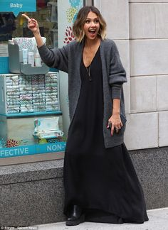 Quite animated: The mother of two goofed around while outside a local branch of Buybuy BAB...