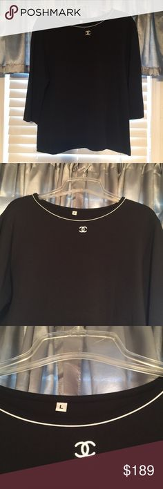 CHANEL Vintage Uniform Shirt Black Big Logo CC '01 This shirt is absolutely stunning and can be worn casually or dressed up, let be honest, it's Chanel! This gorgeous Nylon and Lycra shirt is solid black, with 3/4 length sleeves, and a delicate white trim around the high crew neck Neckline. Features Embroidered CC logo in white in the center of the neckline. In excellent gently loved condition, came directly from a family member who worked at Chanel, guaranteed authentic. Size Large, but…