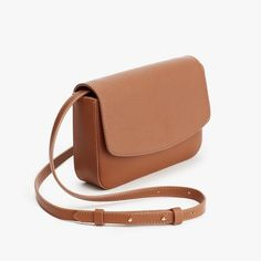 The Cuyana Mini Bag does it all. Crafted in Turkey and leveraged from Italian pebbled and smooth leathers, it is a multi-tasking masterpiece' easily transitioning into a clutch, shoulder bag or belt bag, depending on your mood. Big Bags, Cute Bags, Leather Duffle Bag, Brown Crossbody Bag, Girls Bags, Casual Bags, Backpack Bags, Mini Bag, Fashion Bags