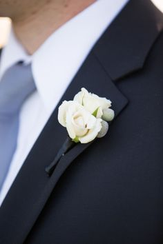 Elegant white rose boutonniere: http://www.stylemepretty.com/little-black-book-blog/2014/09/25/elegant-chicago-wedding-at-fultons-on-the-river/ | Photography: Cristina G - http://cristinagphoto.com/