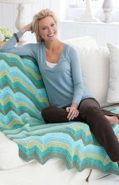 Hills & Plateaus Throw Crochet Pattern-This ripple throw combines up-and-down peaks with flat plateaus for a modern twist on the classic crochet ripple pattern. Crochet it in cool colors for a relaxing accent in the bedroom or your favorite spot for winding down.