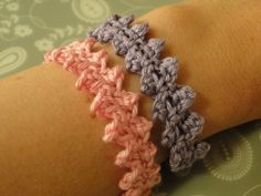 Pink and purple crochet bracelets worn side by side make a fun combo. This is called the button braid;and the pattern is free!