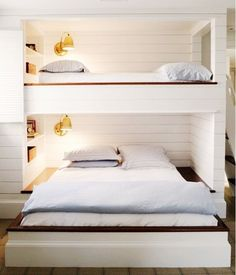 Sharing a room with a sibling can be a nightmare more for your sanity than your children's—especially if there is an age gap. Try using a bunk bed like this that works for an older and younger sibling. With clean white siding like this, you can't go wrong.