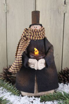Snowman holding candle... just LOVE this guy - he looks like a cast member from 'Scrooge' ....(Muppet version)