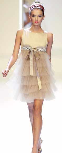 Valentino...this is genius really...the skirt almost looks like those fibre optic glass filaments...and the tulle is so sheer you can see the shape of her body as a different colour...genius